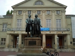 Goethe and Schiller before the theater building in Weimar