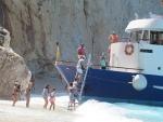 The boat leaves, Porto Katsiki, Greece