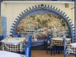 Painted wall, Roda, Greece
