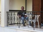Teije on the balcony in Roda, Greece