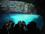 With a boat in the Melissani cave, Kefalonia, Greece