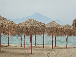 View of the holy Mount Athos from an empty beach in Sithonia