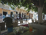 Taking a break in the shade on a terrace in Andros town, Greece