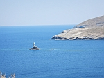 The lighthouse off the coast of Andros city, Greece